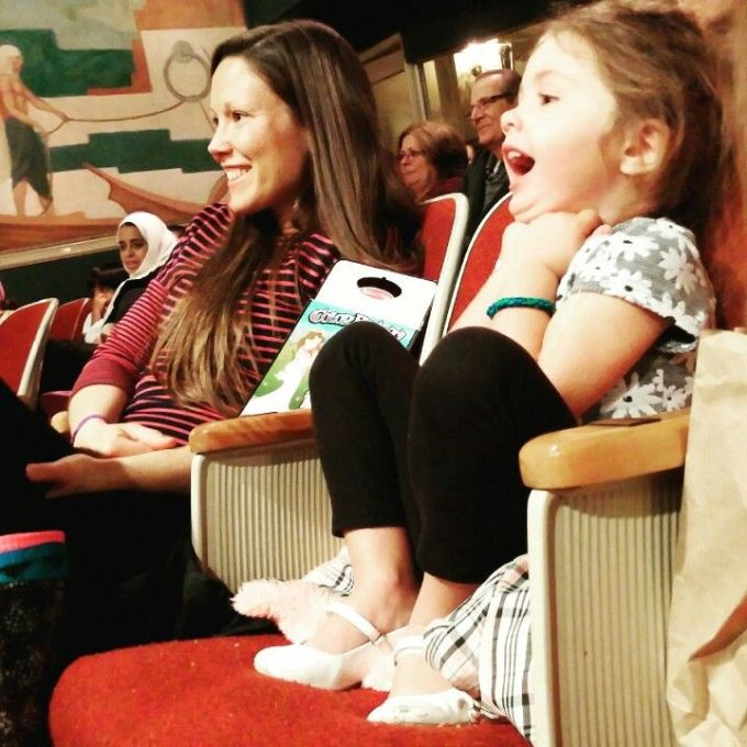 Jessica and her daughter sitting in a theater